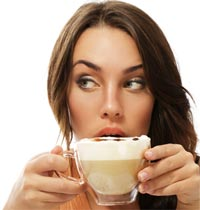 Woman drinking coffee before a marathon